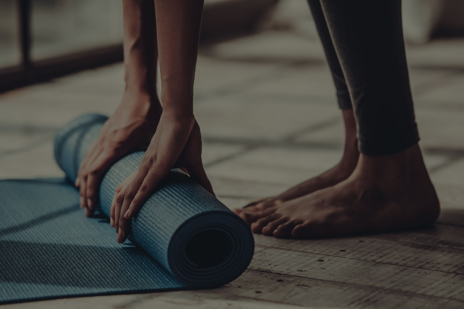 Cropped image of Afro American rolling yoga mat